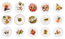 在白色隔绝的套各种各样的鱼开胃菜 免版税库存图片