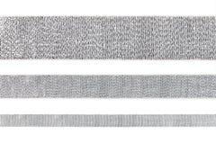在白色隔绝的套平直的发光的银色丝带,设计元素 图库摄影