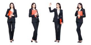 在白色隔绝的套美丽,可爱的女实业家 事务,事业成功概念 库存照片