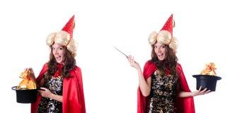 在白色隔绝的女性魔术师 免版税库存图片