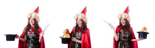 在白色隔绝的女性魔术师 免版税库存照片