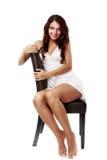 在白色隔绝的女用贴身内衣裤的逗人喜爱,性感的妇女 免版税库存照片