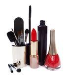 在白色隔绝的妇女的化妆用品 库存照片