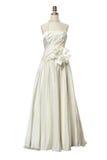 在白色隔绝的婚礼礼服 免版税库存图片