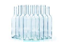 在白色隔绝的小组空的玻璃瓶 库存照片