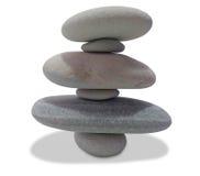 在白色隔绝的平衡的小卵石 库存图片