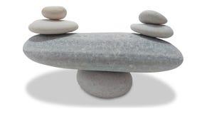 在白色隔绝的平衡的小卵石 免版税图库摄影