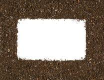 在白色隔绝的庭院土壤纹理框架背景顶视图 免版税库存图片