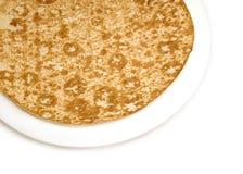 在白色隔绝的开胃含沙棕色薄煎饼 库存图片