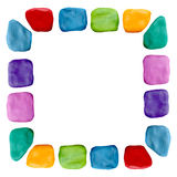 在白色隔绝的彩色塑泥五颜六色的彩虹框架雕塑 库存图片