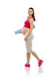 在白色隔绝的怀孕的健身妇女 图库摄影