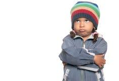 在白色隔绝的恼怒的矮小的多种族女孩 免版税库存图片