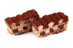 在白色隔绝的提拉米苏蛋糕 免版税库存图片