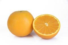 在白色隔绝的新鲜的黄色桔子 库存照片