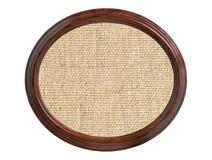 在白色隔绝的木制框架的亚麻制粗麻布纹理 免版税图库摄影
