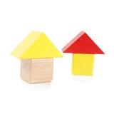 在白色隔绝的木玩具房子 免版税图库摄影