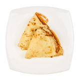 在白色隔绝的板材的薄煎饼 图库摄影