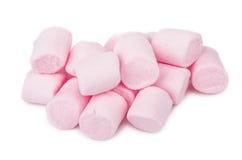 在白色隔绝的桃红色嚼的蛋白软糖堆  免版税库存图片
