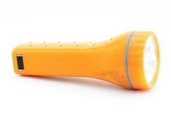 在白色隔绝的橙色手电 免版税库存照片