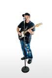在白色隔绝的歌手吉他弹奏者看起来正确 库存照片