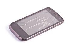 在白色隔绝的残破的屏幕智能手机 免版税库存图片