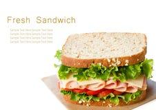 在白色隔绝的火腿三明治 库存照片