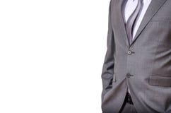 在白色隔绝的灰色衣服的商人 库存照片