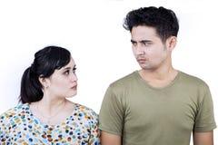 在白色隔绝的特写镜头恼怒的夫妇 免版税库存图片