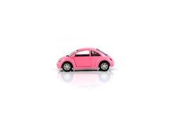 在白色隔绝的玩具汽车 库存图片