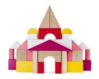 从在白色隔绝的玩具砖的五颜六色的塔城堡 库存图片