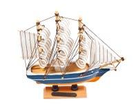 在白色隔绝的玩具船 免版税库存图片