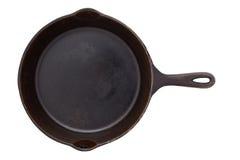 在白色隔绝的生铁煎锅 免版税库存照片