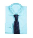 在白色隔绝的男性蓝色衬衣 库存图片