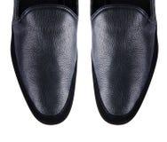 在白色隔绝的男性鞋子技巧  免版税库存图片