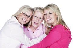 在白色隔绝的白肤金发的妇女的三世代 库存照片