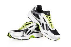 在白色隔绝的白色运动鞋 免版税库存图片