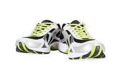 在白色隔绝的白色运动鞋 免版税图库摄影