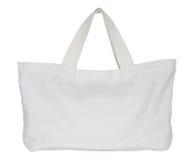 在白色隔绝的白色织品袋子 免版税库存照片