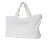 在白色隔绝的白色织品袋子 库存照片