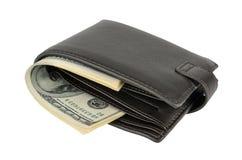 在白色隔绝的皮革钱包的金钱 图库摄影