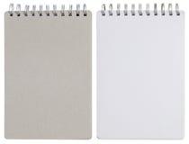 在白色隔绝的空白的螺纹笔记本 免版税库存照片