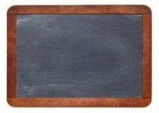 在白色隔绝的空白石板黑板 库存图片
