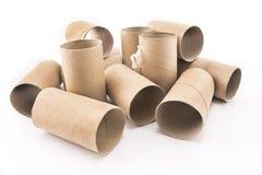 在白色隔绝的空的卫生纸卷 免版税库存照片