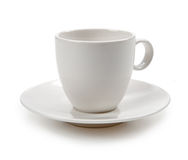 在白色隔绝的空的咖啡杯 库存图片