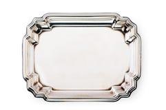 在白色隔绝的空的银色盘子 免版税库存图片