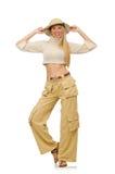 在白色隔绝的米黄长裤的俏丽的妇女 免版税库存图片