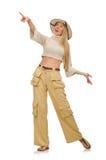在白色隔绝的米黄长裤的俏丽的妇女 免版税库存照片