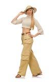 在白色隔绝的米黄长裤的俏丽的妇女 免版税图库摄影