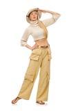 在白色隔绝的米黄长裤的俏丽的妇女 库存图片
