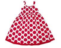 在白色隔绝的红色斑点的女性孩子礼服 女孩党穿戴 免版税库存图片